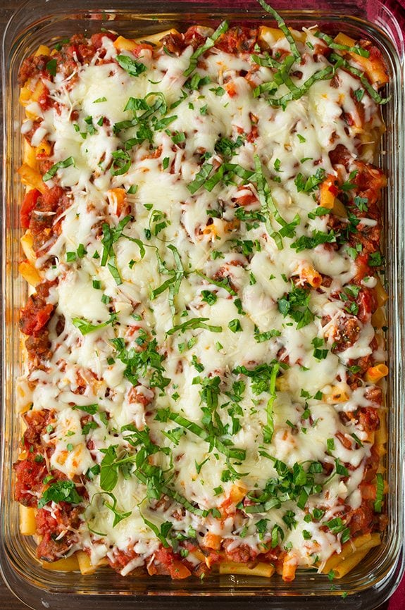 Easy Baked Ziti in cooking dish topped with cheese and parsley