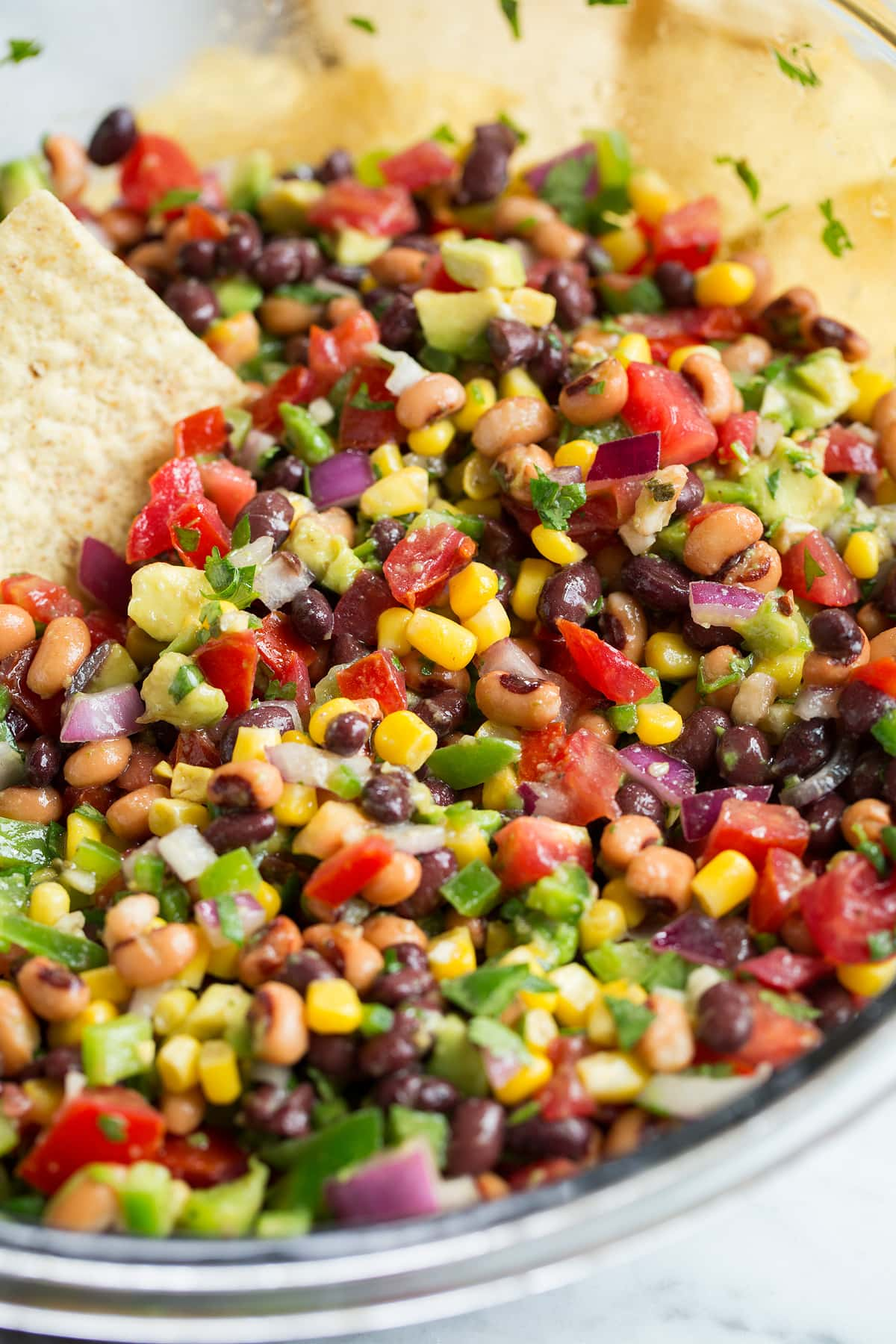 Cowboy Caviar in glass bowl with tortilla chips