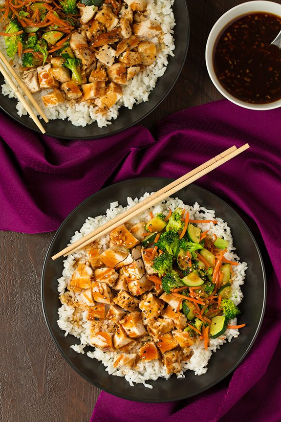 two teriyaki bowls with chopsticks