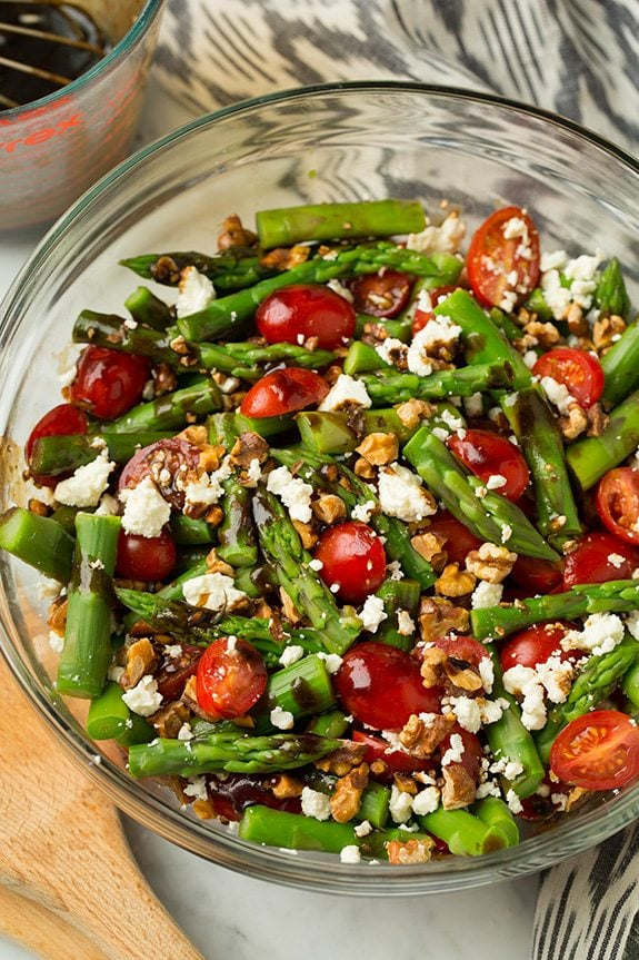 Asparagus, Tomato and Feta Salad in a glass bowl