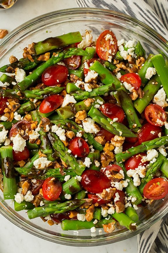Asparagus, Tomato and Feta Salad with Balsamic Vinaigrette in a large glass bowl