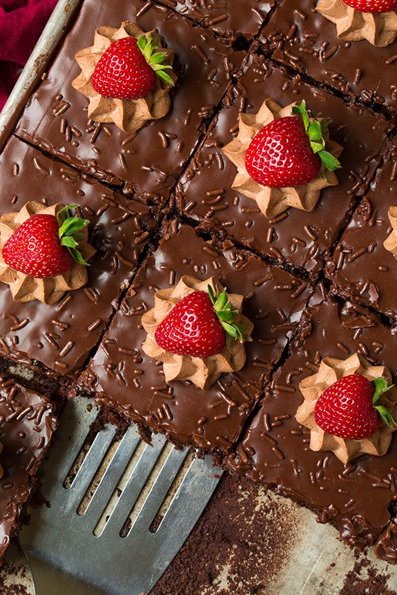 Best chocolate cake in sheet pan topped with mousse and strawberries