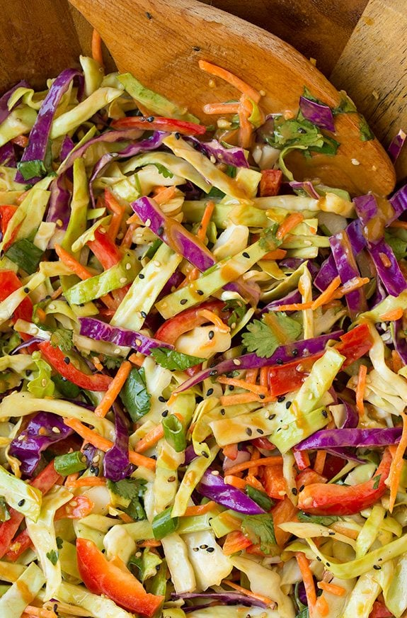 close up of asian slaw tossed with thai peanut dressing