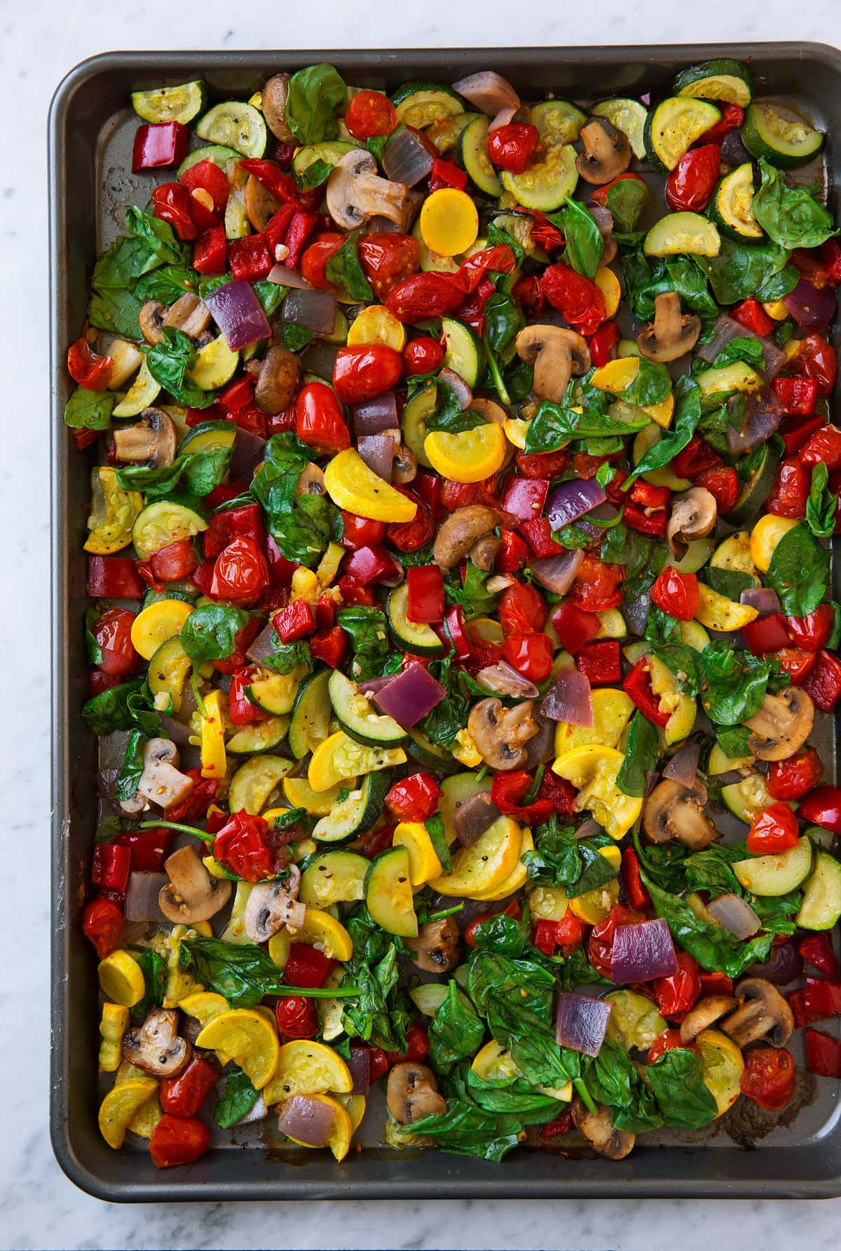 Roasted vegetables on a baking sheet.
