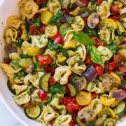 Cheese tortellini with pesto and roasted vegetables.