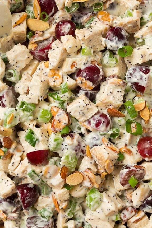 Close up image of chicken salad filling showing chicken, grapes, celery, almonds, green onions and a creamy dressing.