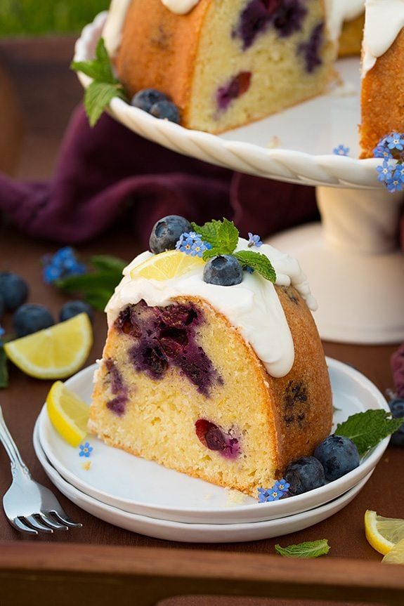slice of Lemon Blueberry Bundt Cake on white plate