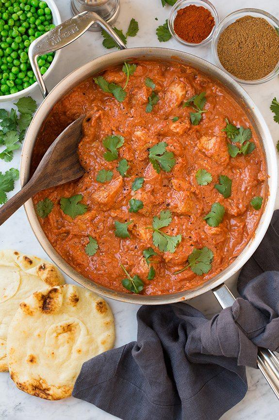 Chicken Tikka Masala in pan garnished with cilantro