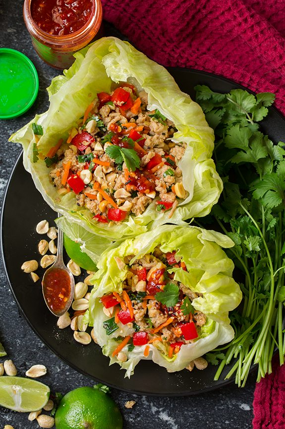 Thai Chicken Lettuce Wraps on plate with fresh cilantro