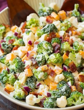 A close up of a broccoli and cauliflower salad in a bowl
