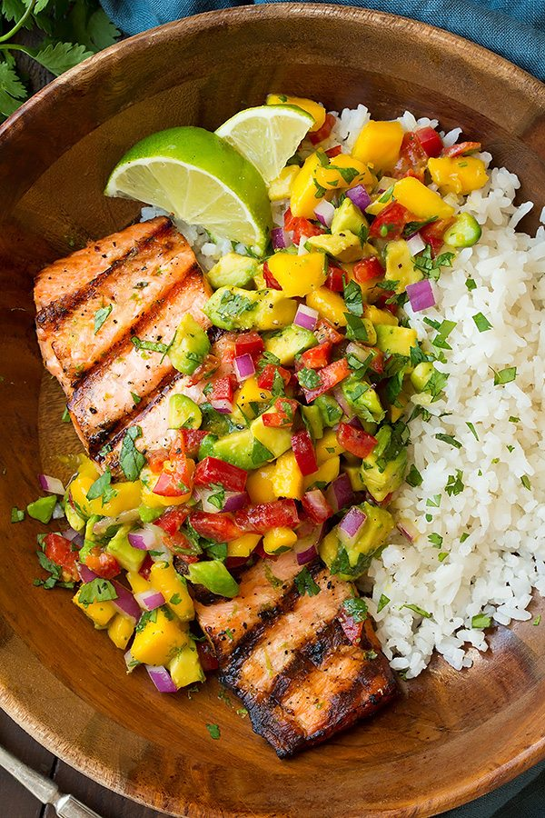 close up of salmon with mango salsa and coconut rice