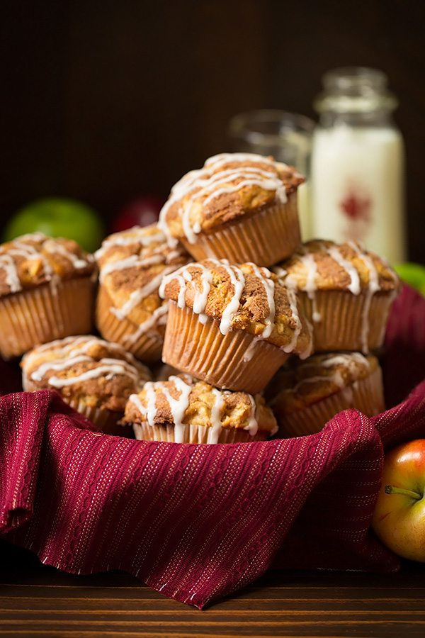 Apple Muffins in a basket lined with a red cloth.