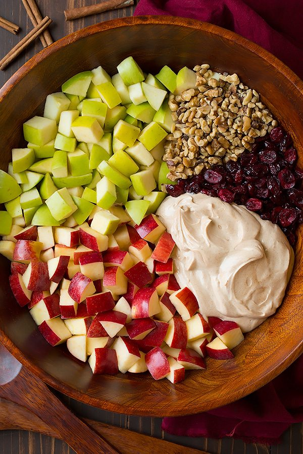 Apple Fruit Salad ingredients in a mixing bowl before tossing.