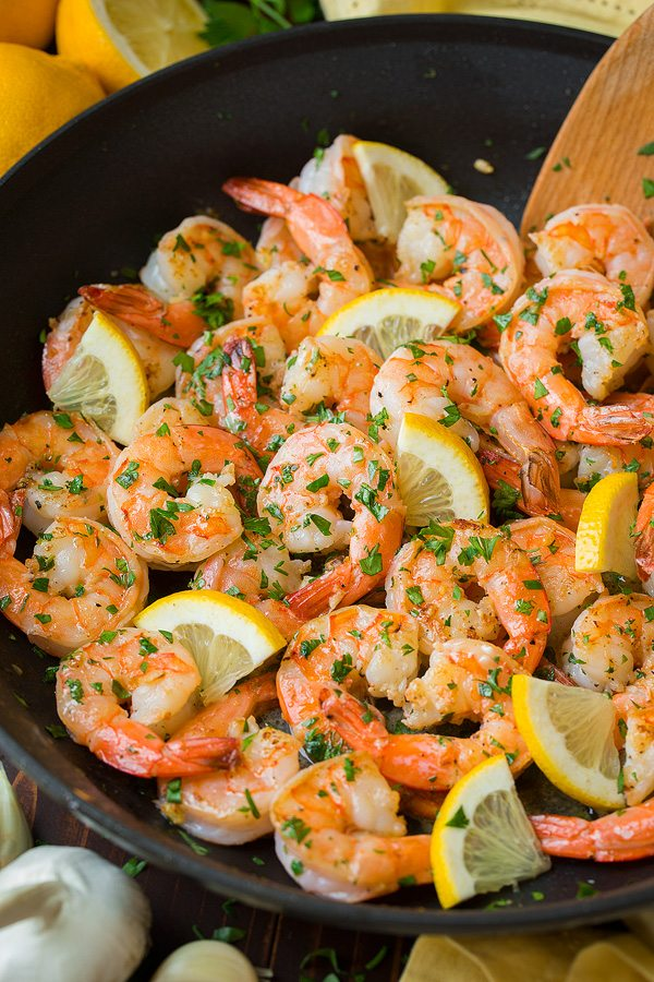Shrimp in skillet after cooking. Tossed with garlic, lemon and butter.