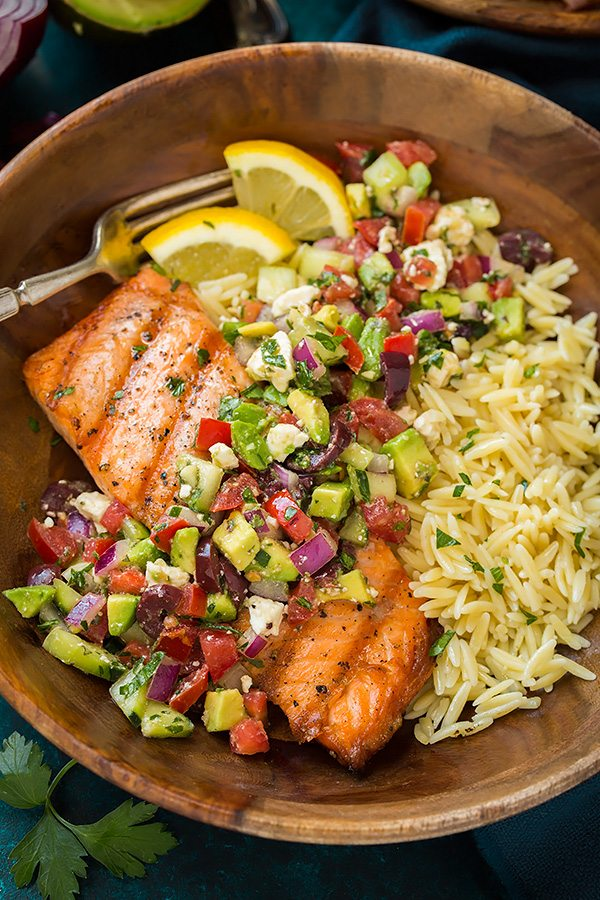 Grilled Salmon in a wooden single serving bowl with Avocado Greek Salsa and Orzo