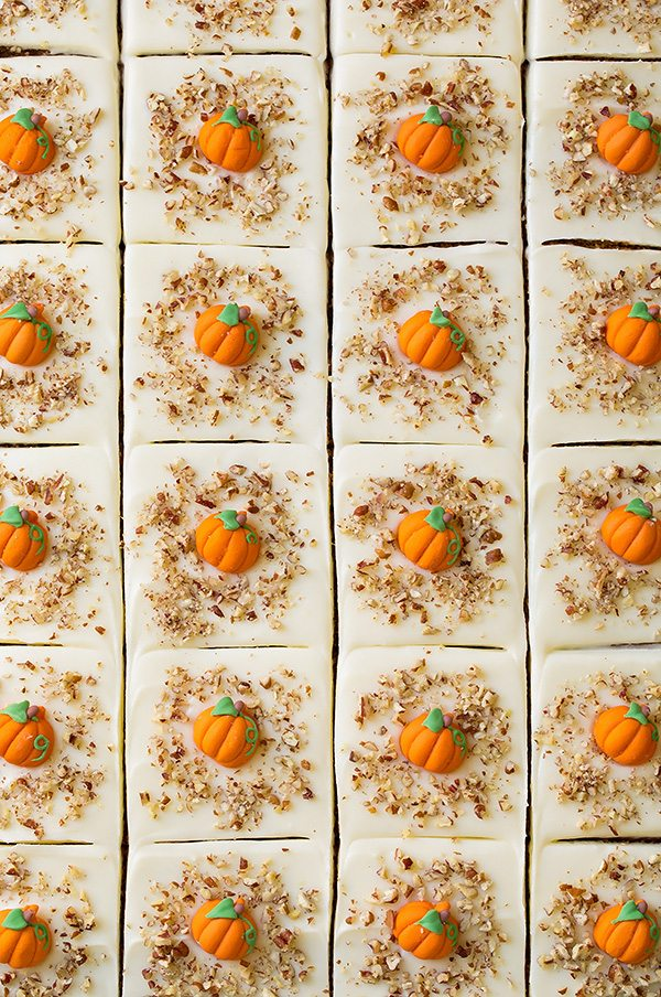 Overhead image of 24 slices of pumpkin cake in a baking sheet.