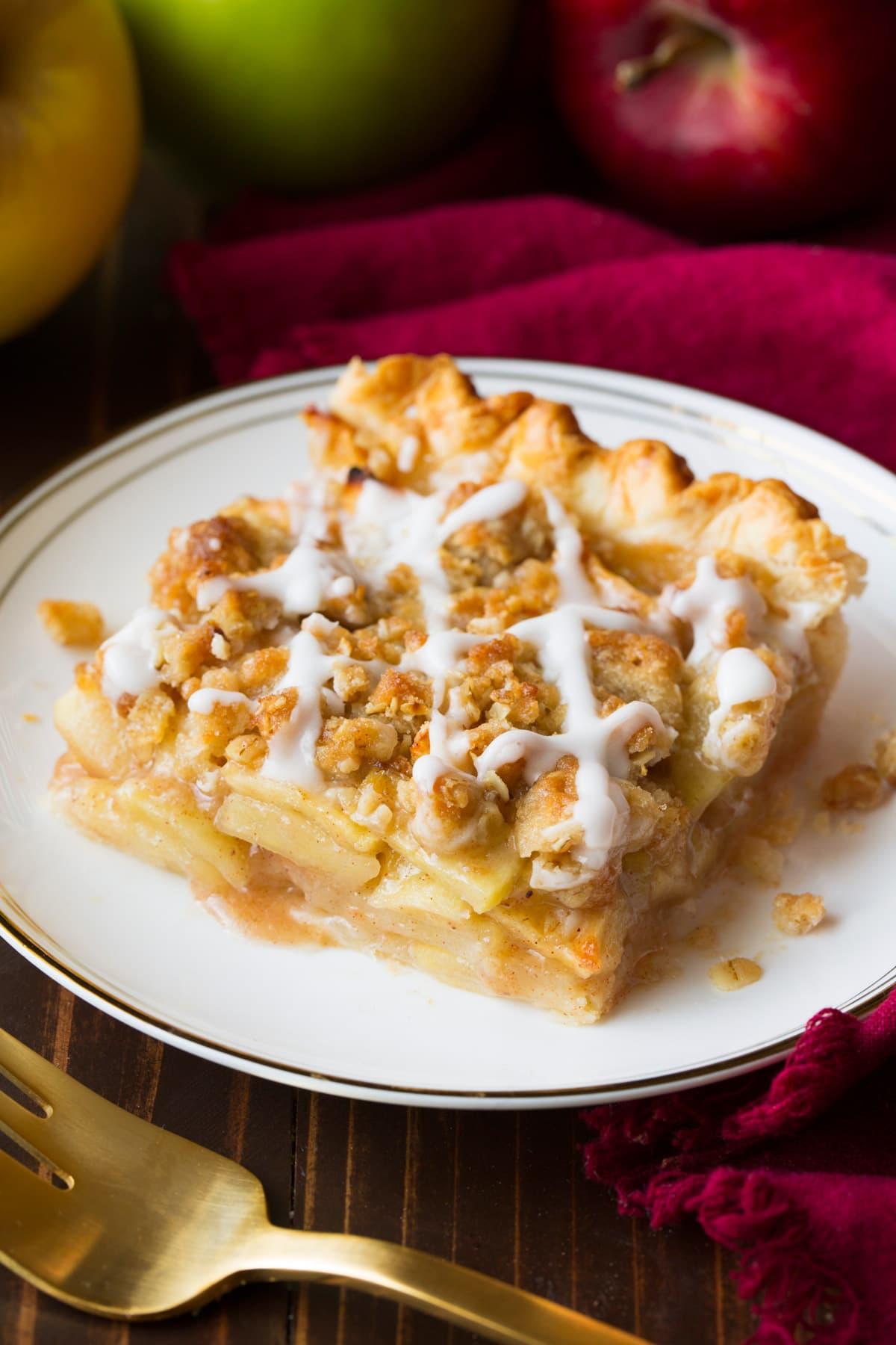 Single slice of apple slab pie on a small dessert plate.
