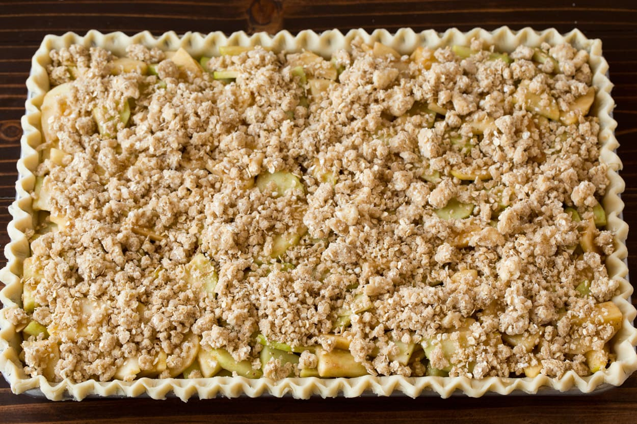 Crumb topping added to apple slab pie.