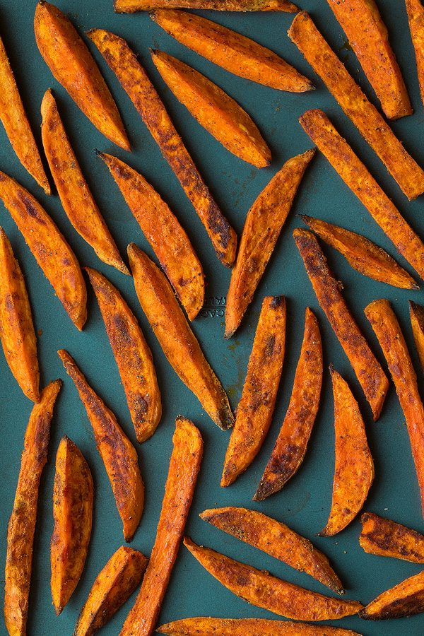 Sweet Potato Fries shown here after baking on dark baking sheet