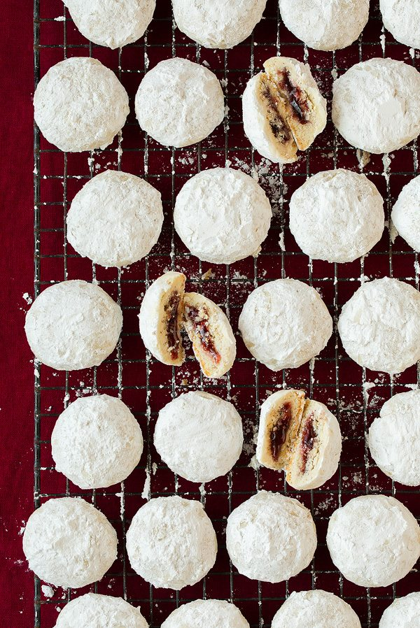 Raspberry Almond Snowball Cookies with jam center.