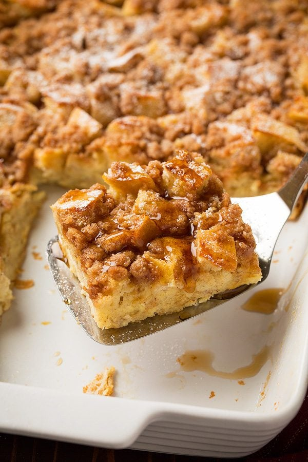 Slice of warm overnight french toast casserole on serving spatula