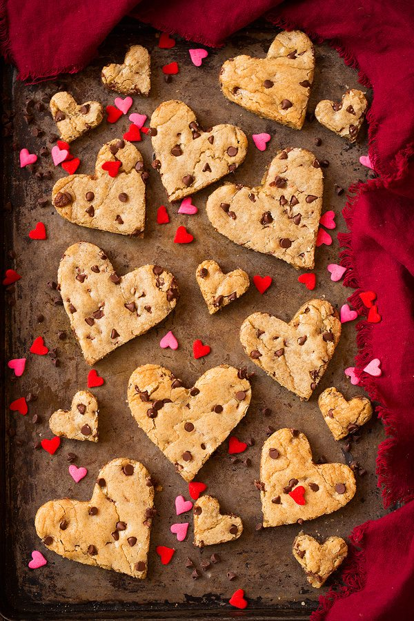 Blondies cut into heart shapes, on a baking sheet.