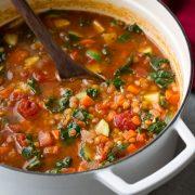 Lentil Soup in a large white cast iron pot