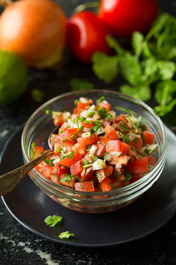 Pico de gallo in a small glass bowl for tostadas