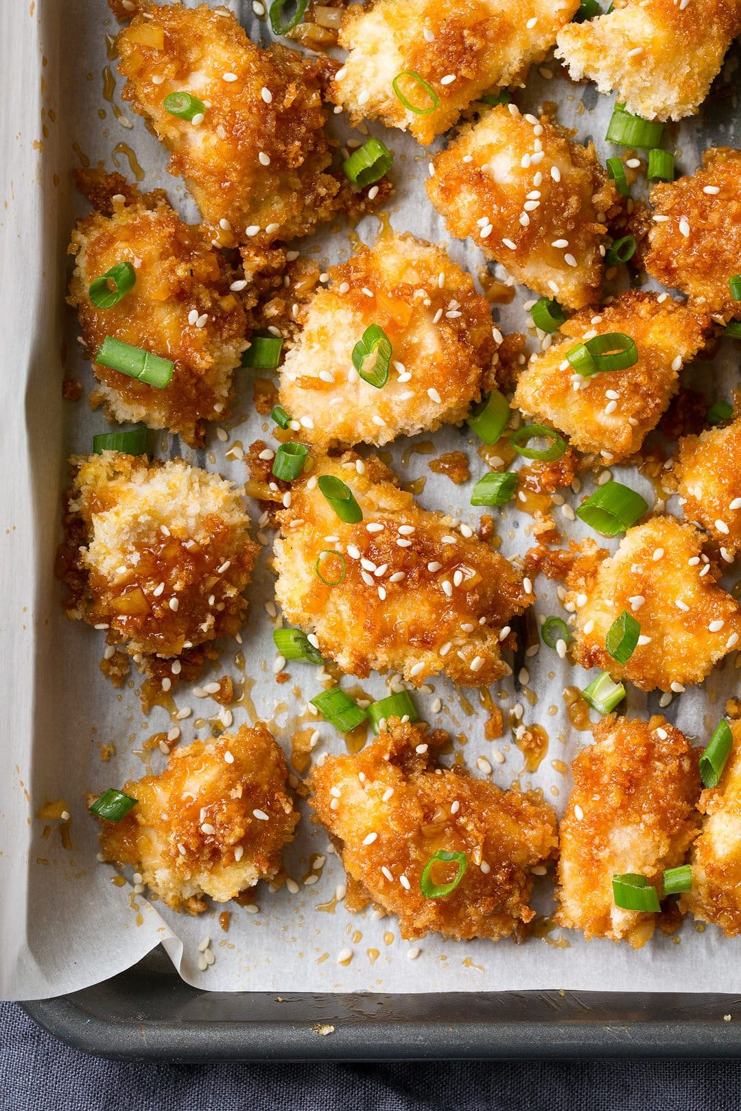 Close up image of honey garlic chicken to show texture of panko and sticky sauce.
