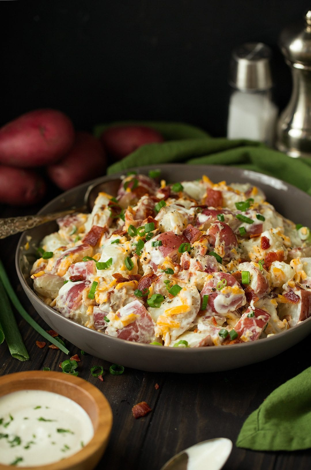 cheddar bacon ranch potato salad in a bowl with a spoon
