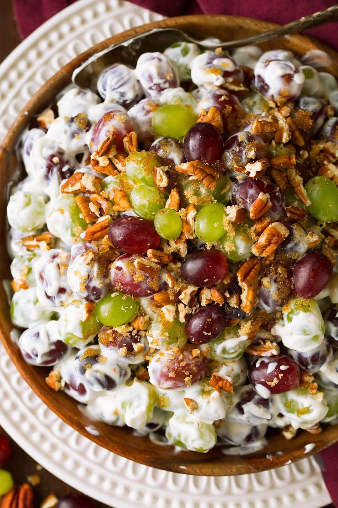 Overhead close up image of grape salad in a large wooden bowl.