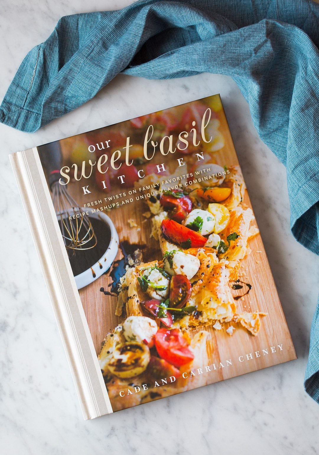 our sweet basil kitchen cookbook on counter with blue towel