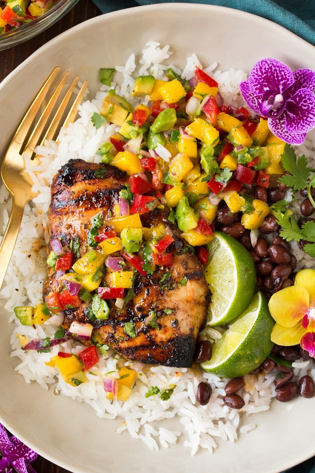 Trade traditional enchilada sauce for a creamy, cheesy topping on this Mexican chicken recipe. Your family will never know they're enjoying a lightened meal. Serve with a salad of fresh mango, jicama, and shredded lettuce topped with a lime vinaigrette.