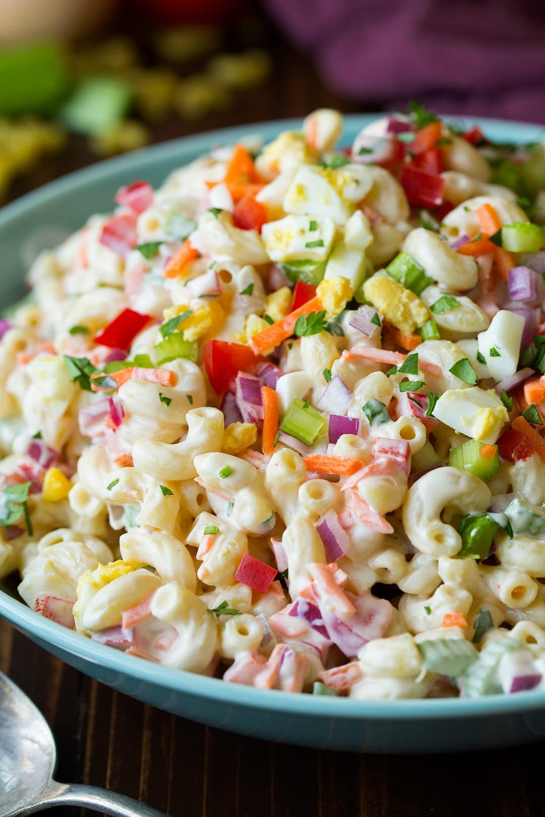 Colorful Macaroni Salad in teal serving bowl
