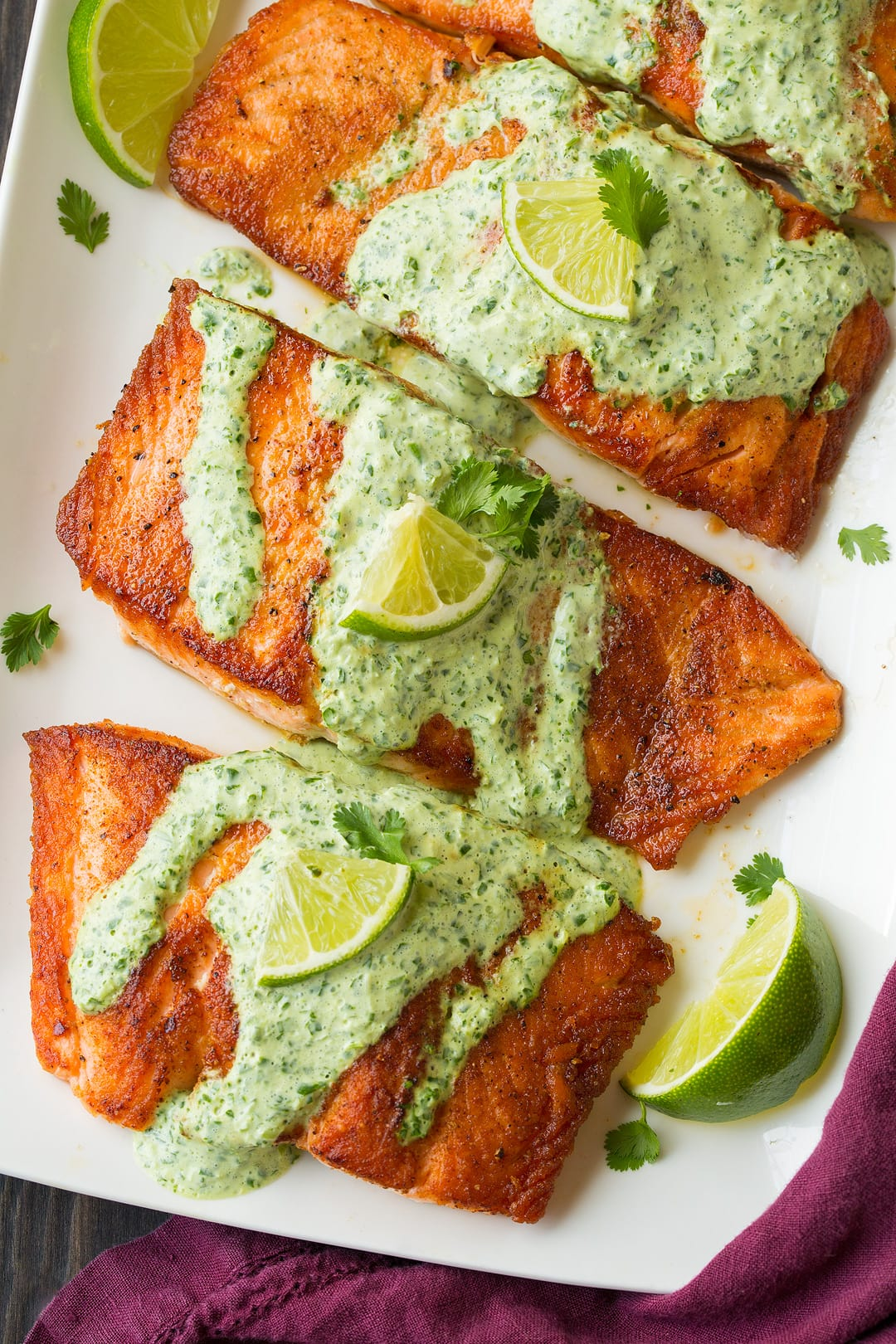 four cilantro lime salmon drizzled with cilantro sauce