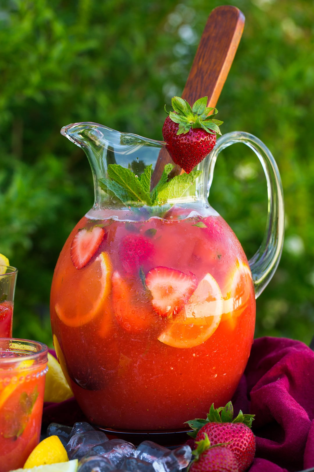 large pitcher of Strawberry Lemonade garnished with fresh strawberry