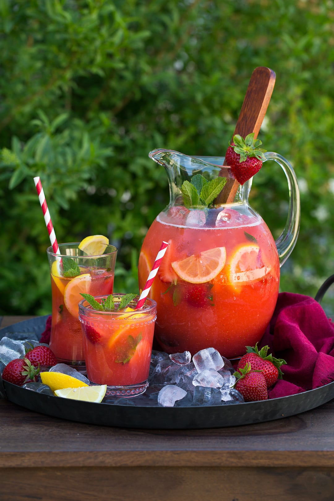 pitcher and two glasses of Strawberry Lemonade on tray