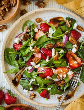 Strawberry Spinach Salad on a plate with balsamic vinegar
