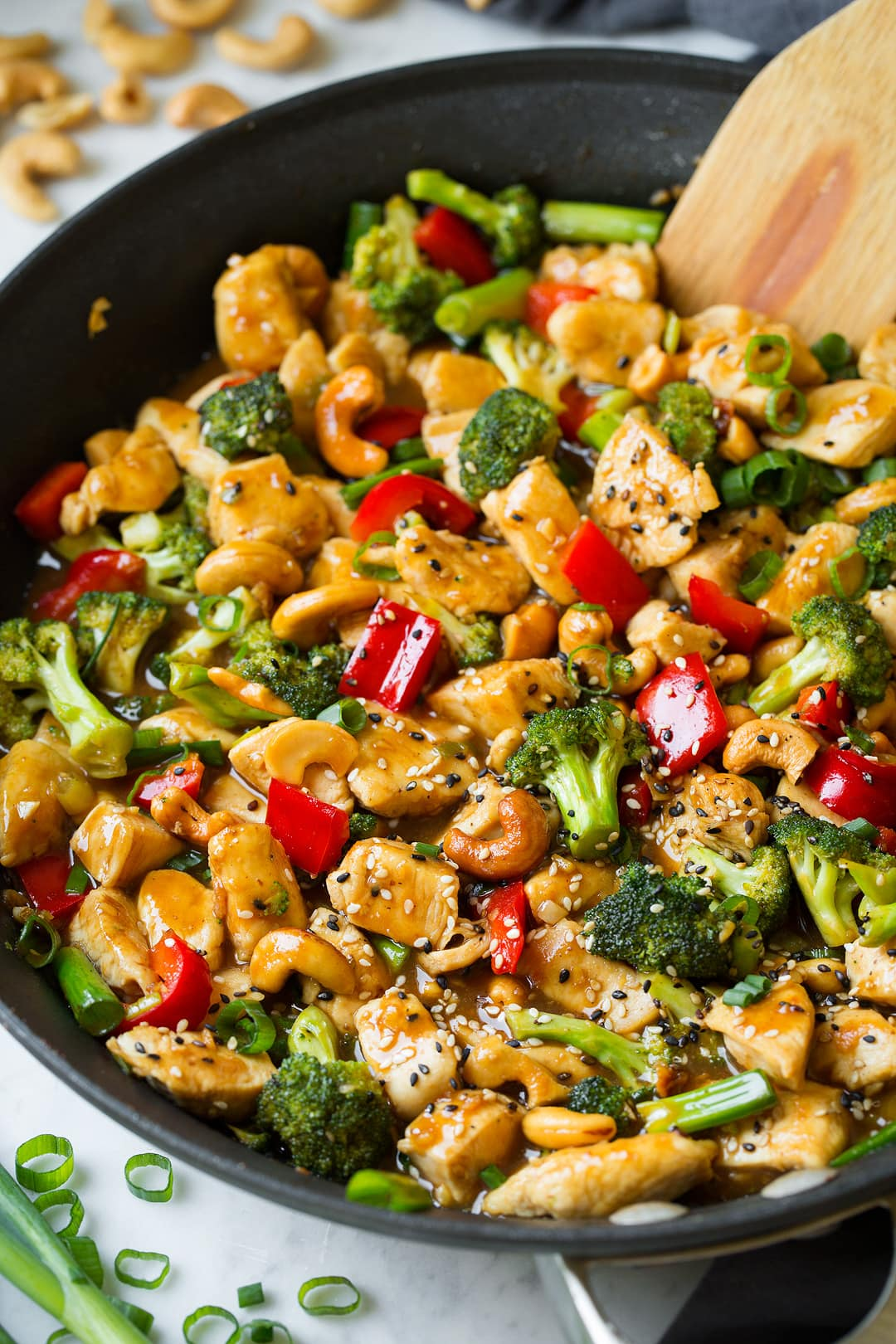 Cashew Chicken shown here in skillet. Includes chicken breasts pieces, broccoli, bell peppers and a sweet and tangy sauce.