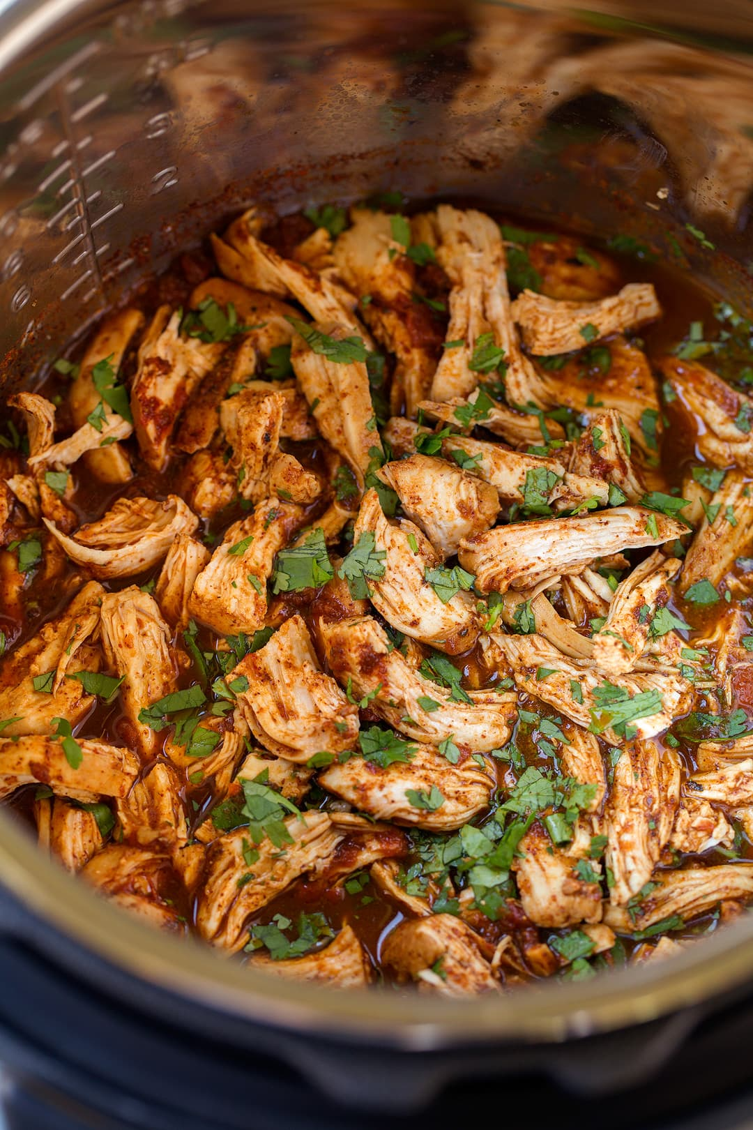 instant pot Salsa chicken after shredding garnished with cilantro.