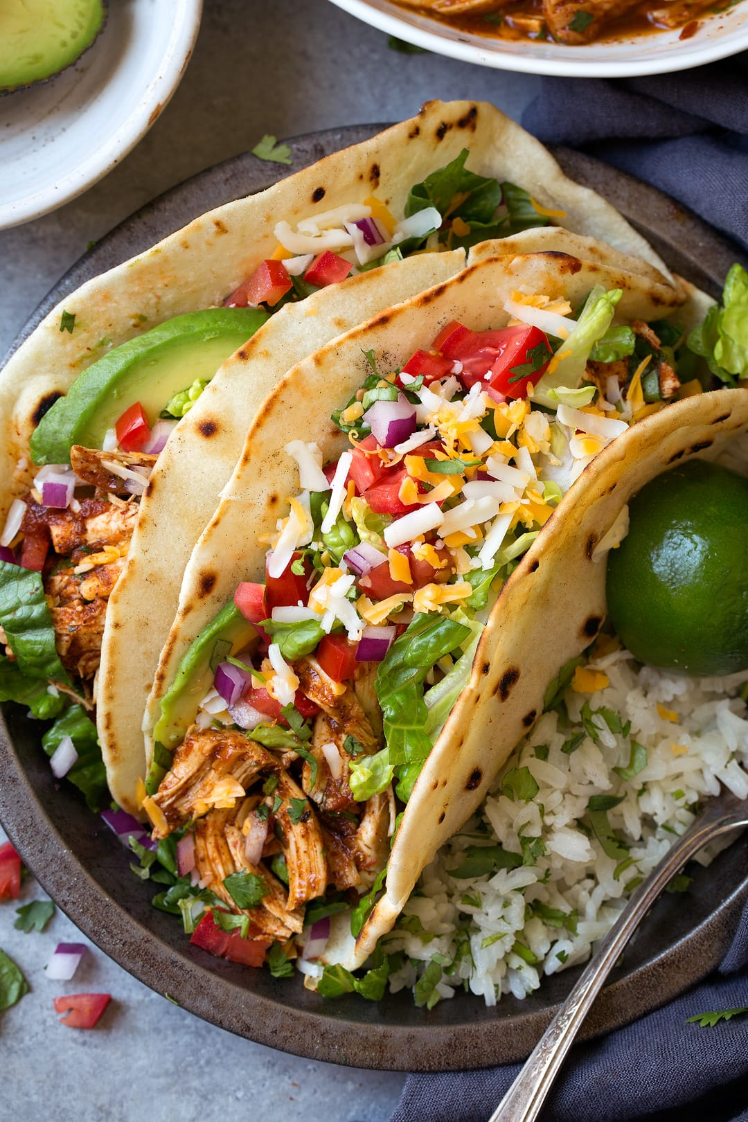 Salsa Chicken Tacos on plate with lime wedges