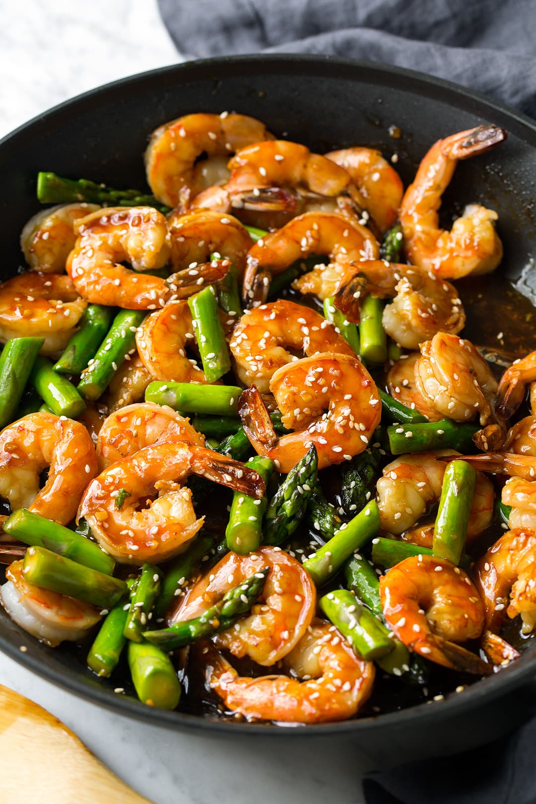 Teriyaki Shrimp and Asparagus stir fry in a large skillet