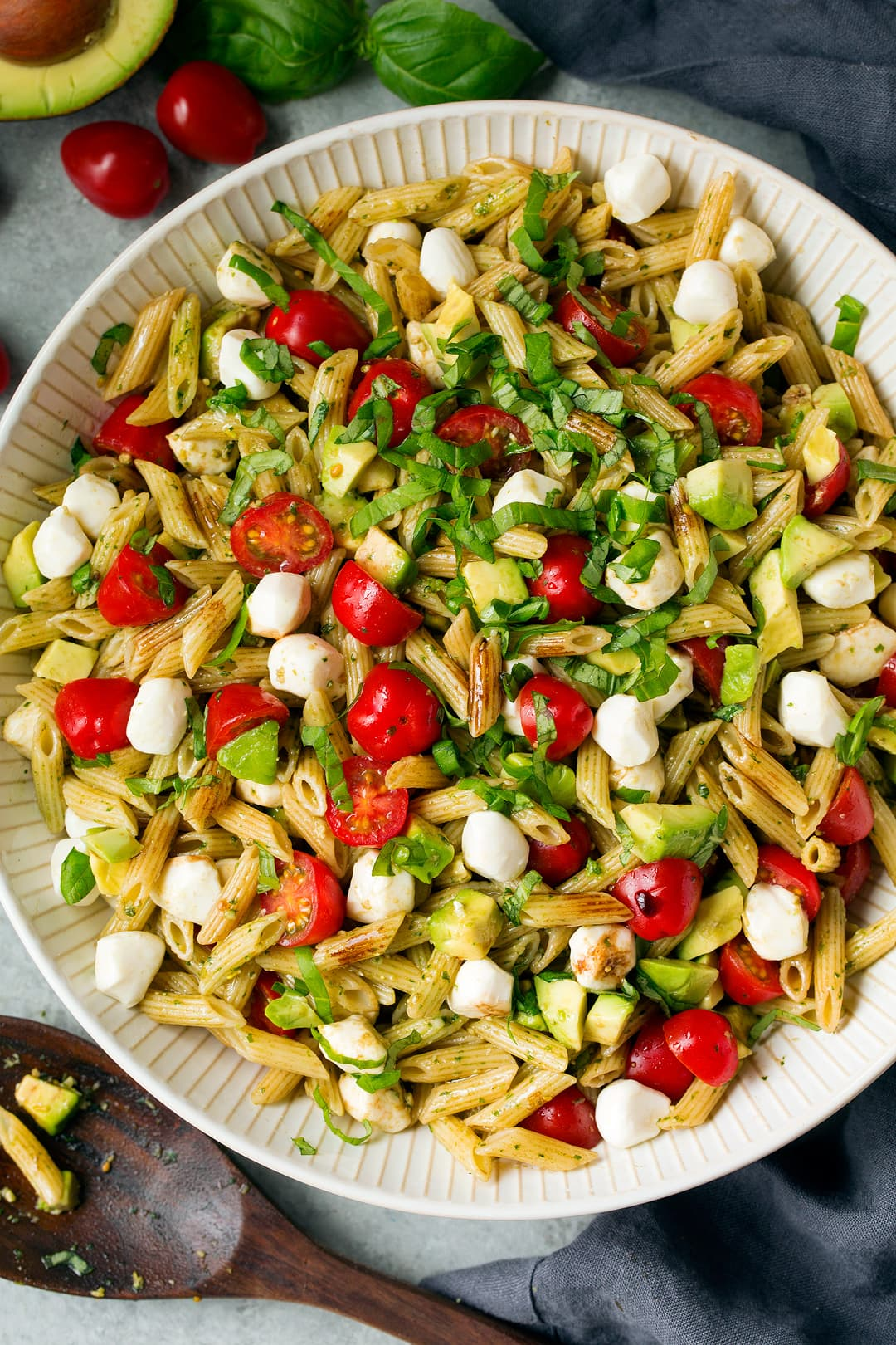 Avocado Caprese Pasta Salad in large white serving bowl