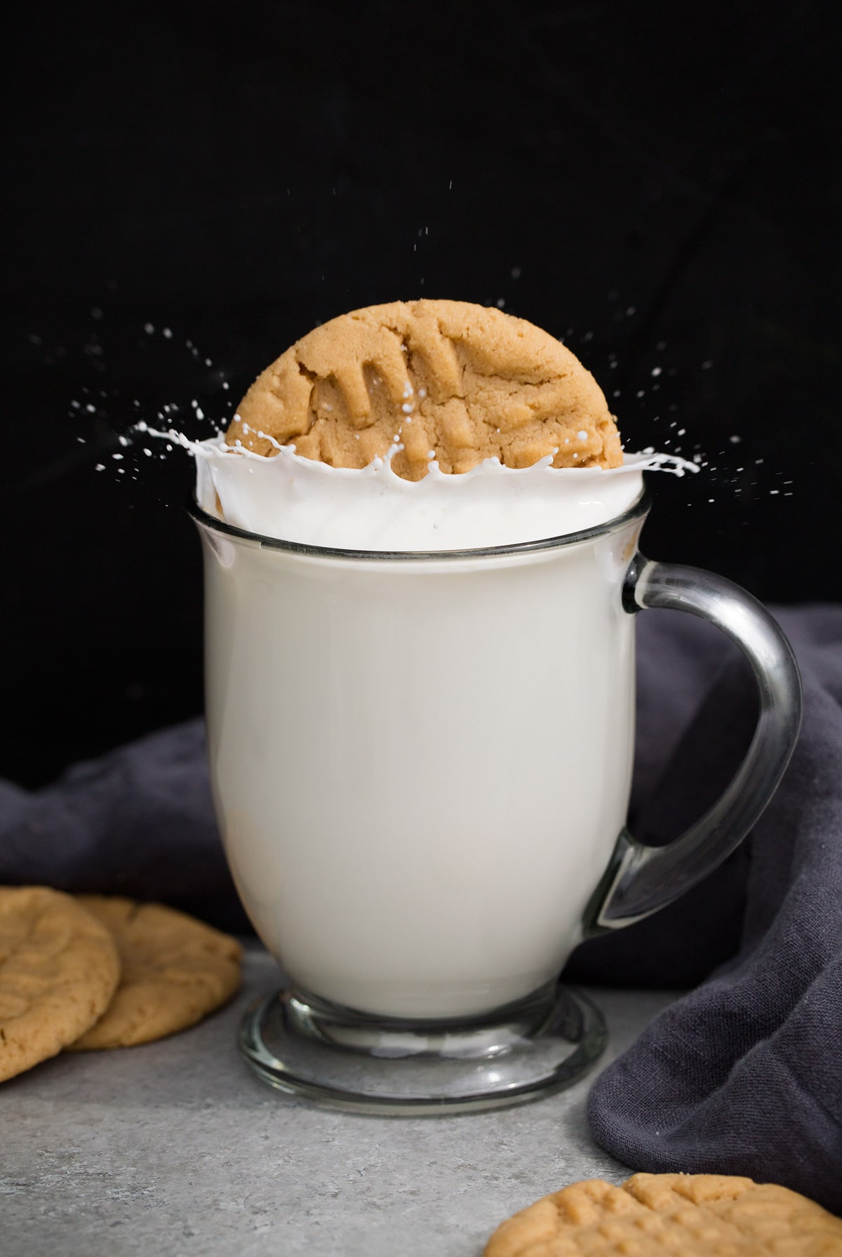Peanut Butter Cookies dropped in milk and splashing.