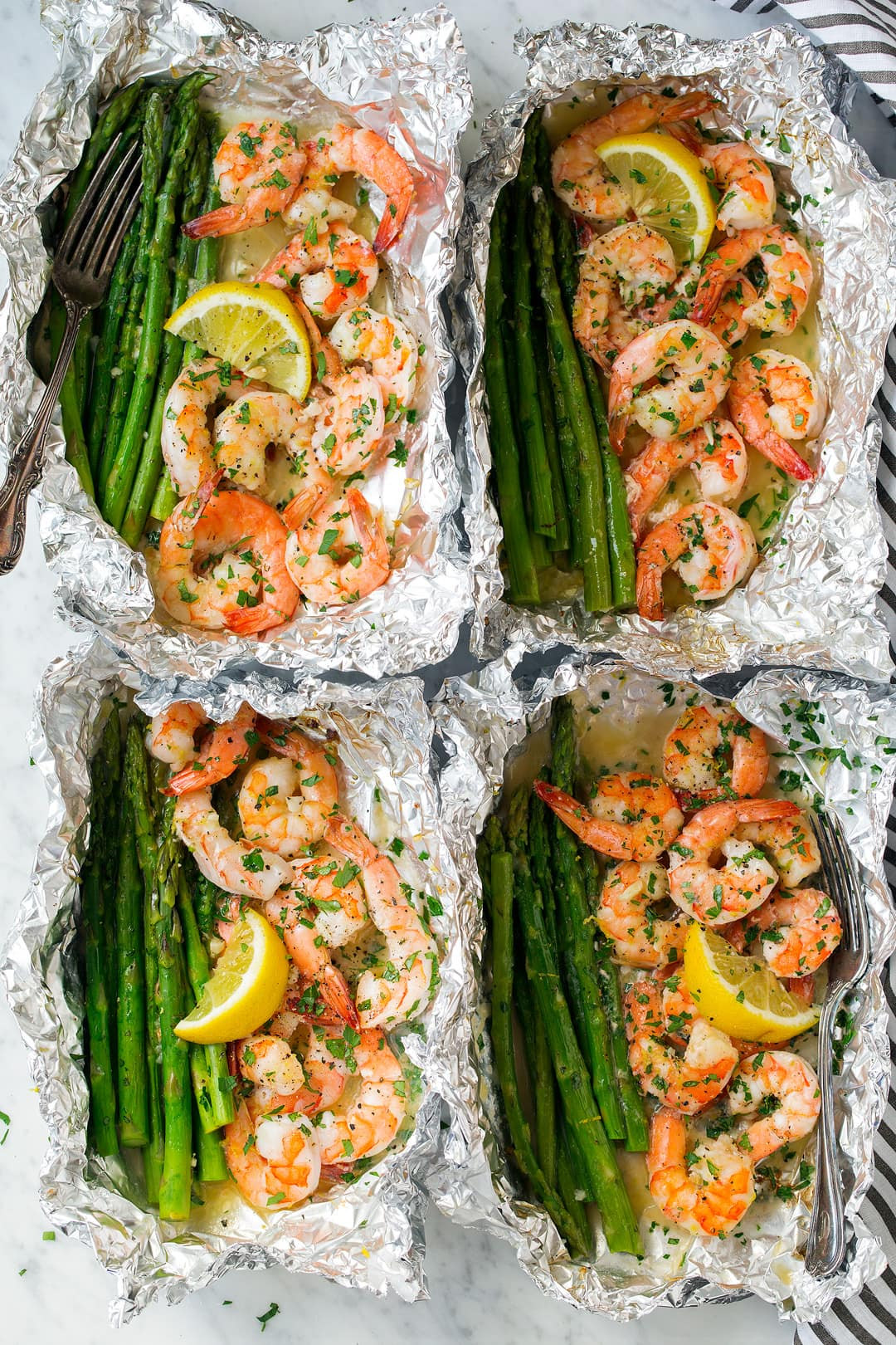 four Shrimp and Asparagus Foil Packs with Garlic Lemon Butter Sauce