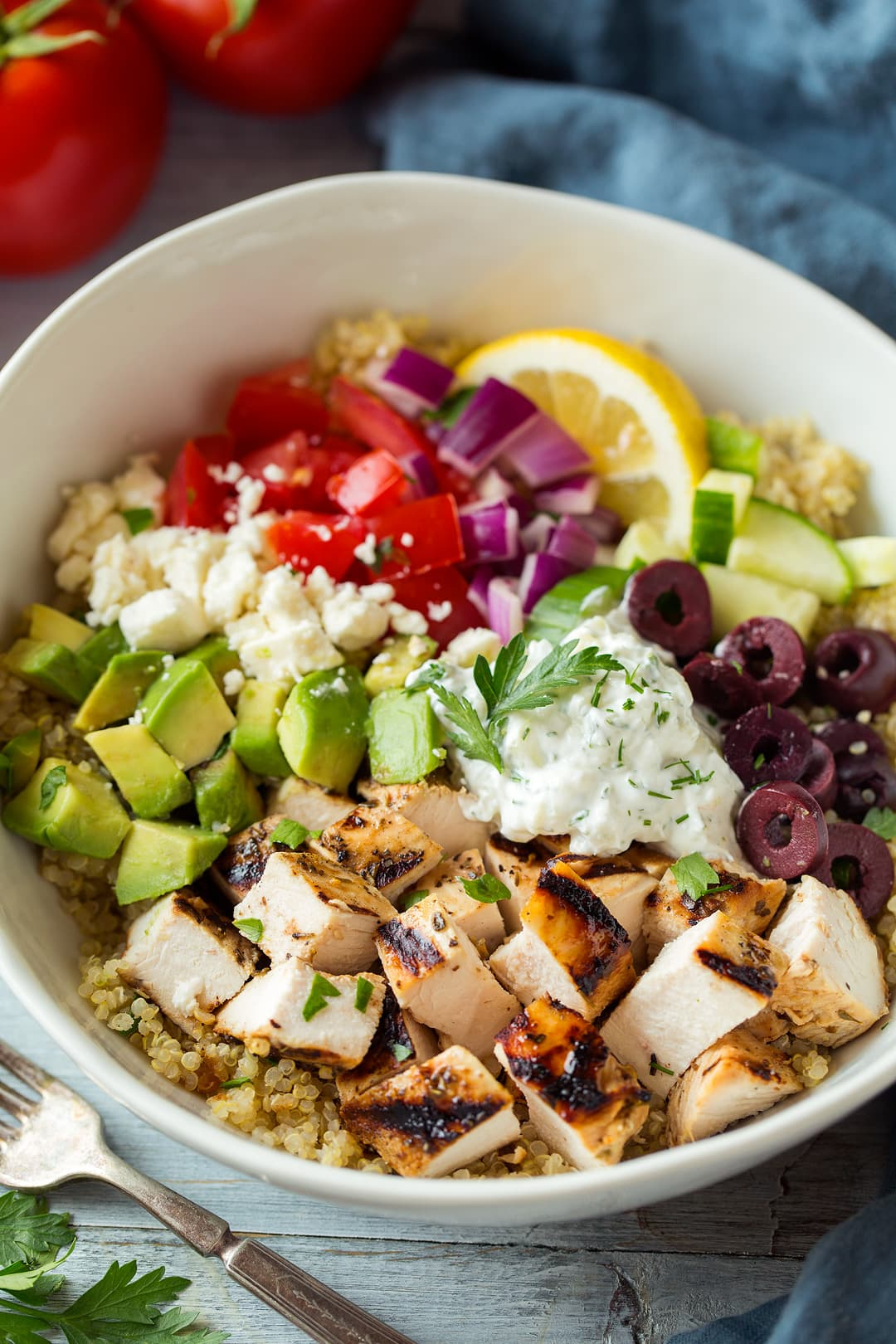 Grilled Greek Chicken Quinoa Bowl topped with tzatziki and avocado