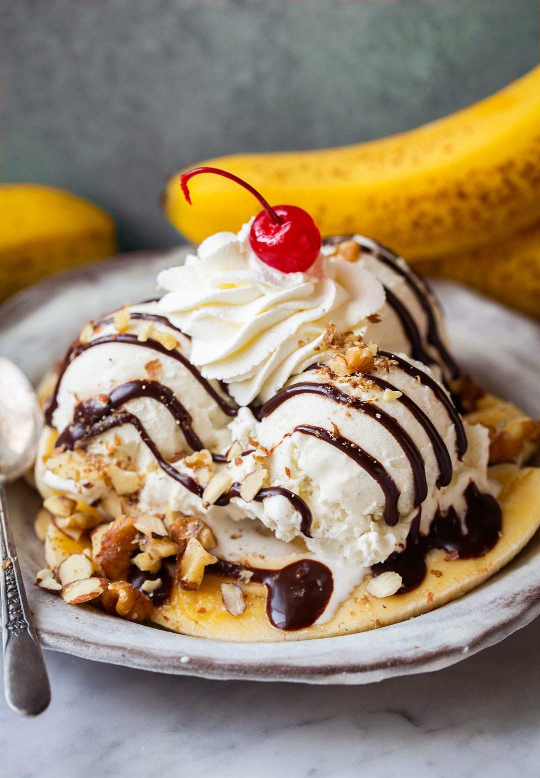 banana split drizzled with homemade hot fudge sauce