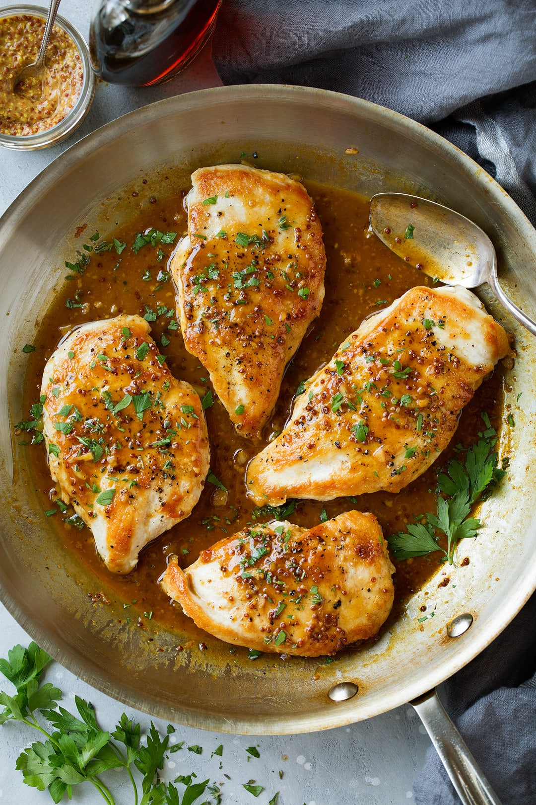 Skillet Chicken with Maple Mustard Sauce shown here in stainless steel 12-inch skillet.