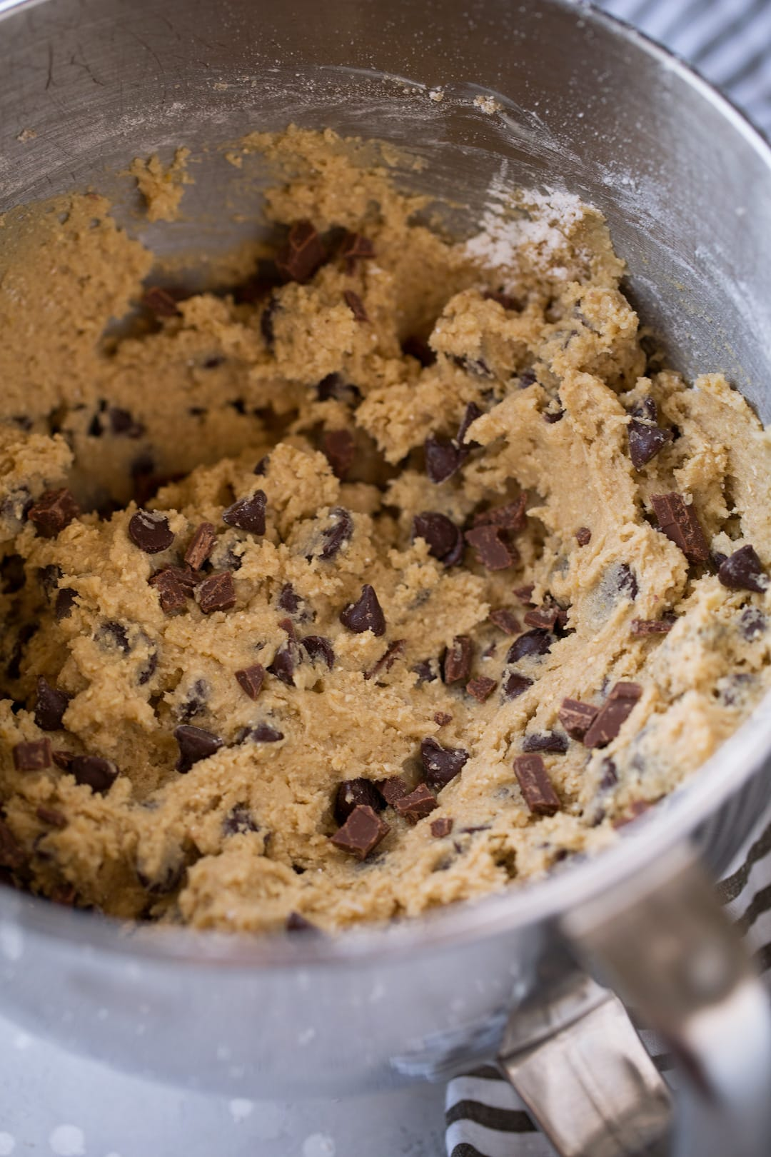 Chocolate chip cookie dough in mixing bowl.