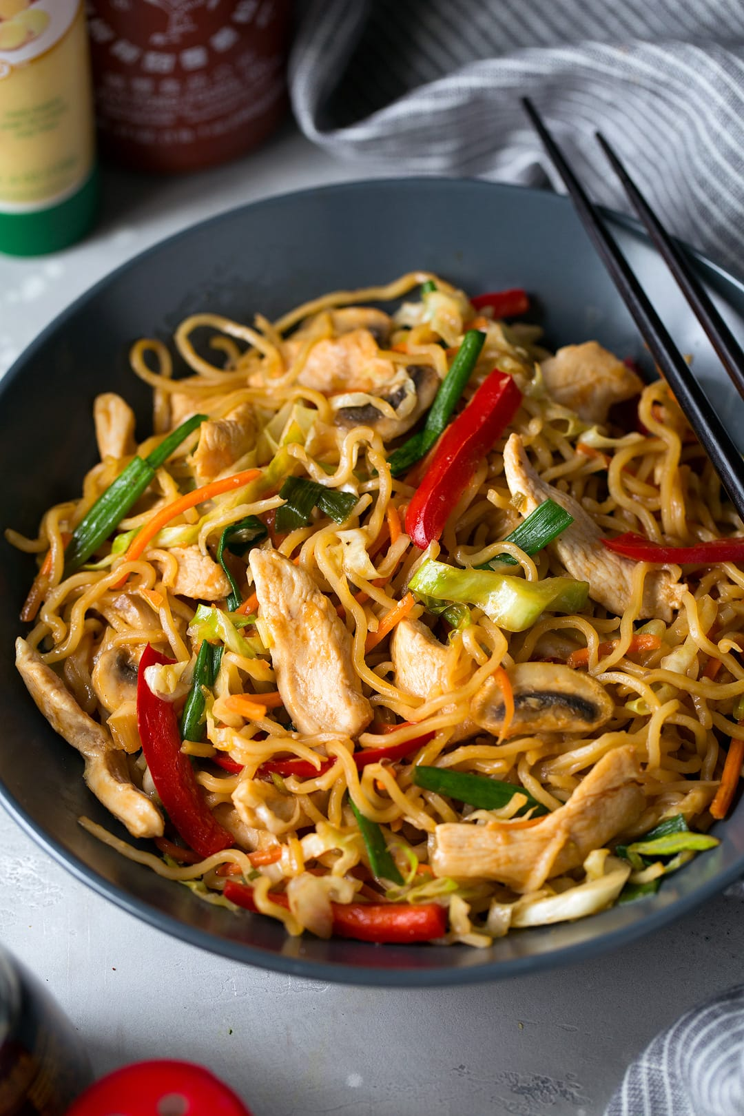 Chicken Yakisoba in gray bowl with chopsticks
